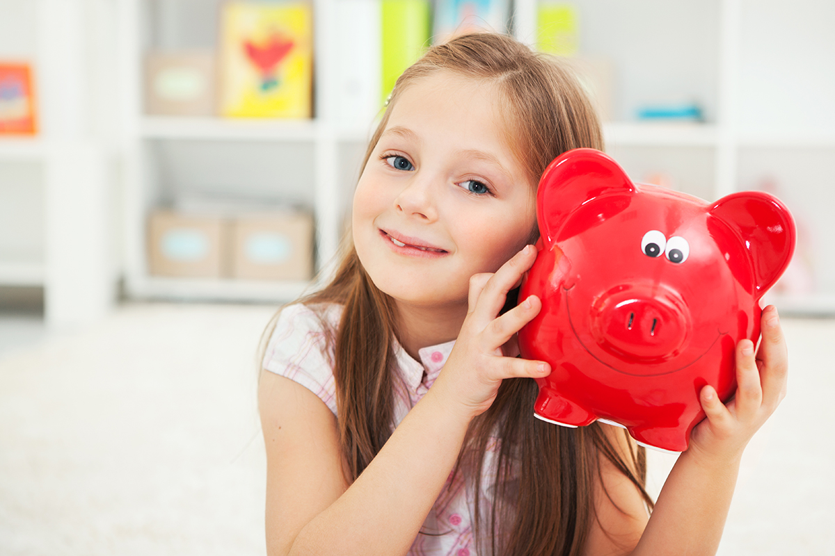 """Cute girl in her room with piggy bank.Please, see more..."""